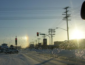 I drove to work chasing sundogs, caught here as I waited at a red light.
