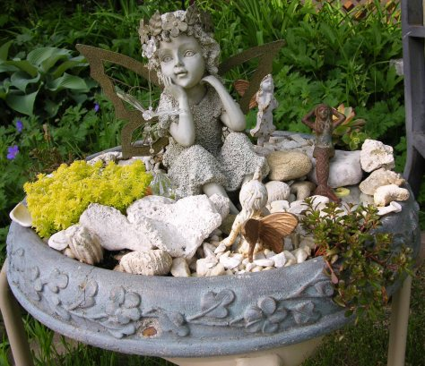 Barb and I planted up this old birdbath for the fairies.